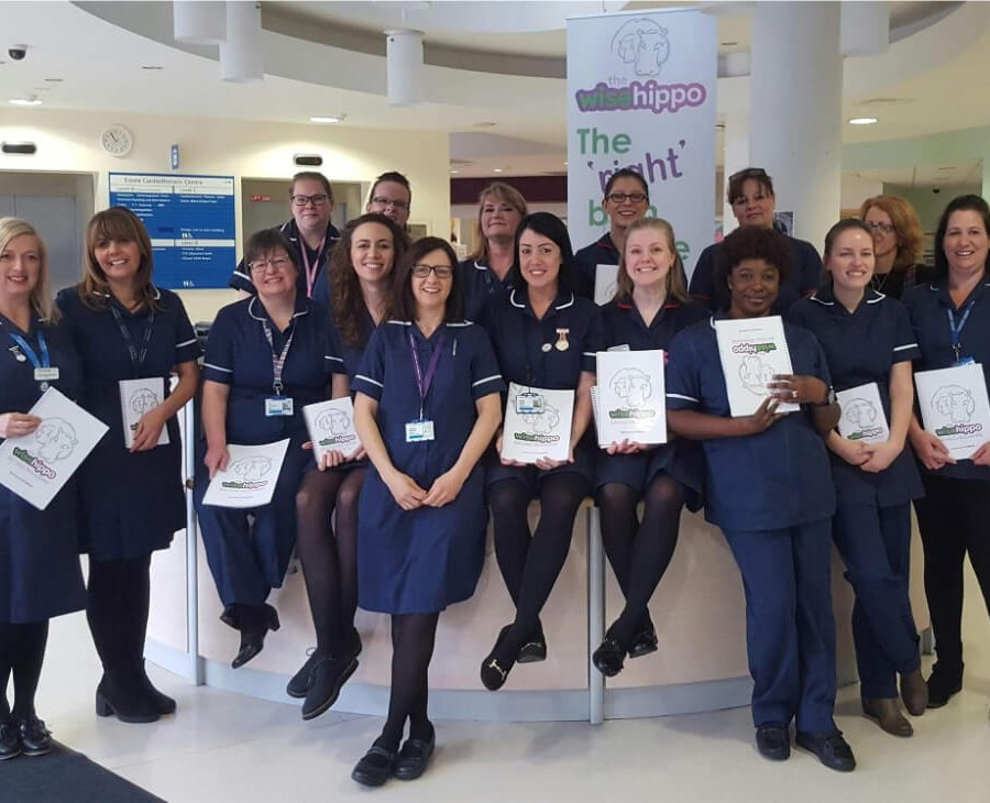 nhs staff with wise hippo books banner